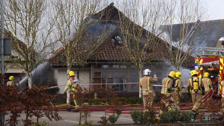 The damage can be seen in the roof of the buildings as the fire is brought under control. Picture: D