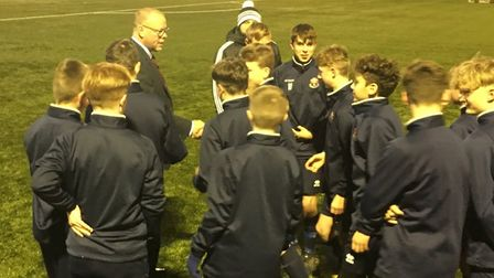 AFC Sudbury first-team boss Mark Morsley, chats to some of the U16s at a training session.
