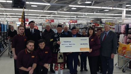 Staff at Sainsbury's in Mildenhall and members of the Royal British Legion with the cheque for over