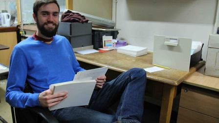Volunteer James working to document the collections. Picture: MICHAEL JAMES STAMPER