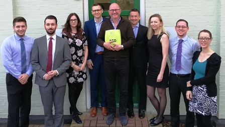 Ryan's chairman Tim Ryan, centre, with the defbrillator and members of the company's team in Ipswich