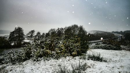 Snow falls on the A14 with wintry shot of the Orwell Bridge in the background. Picture: CARL HARLOTT