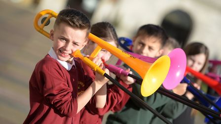Pupils performing with colourful instruments. Picture: SARAH LUCY BROWN