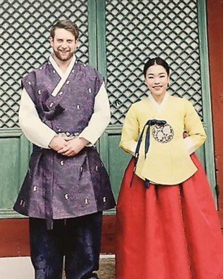 Mike and Jiheyon Harbrow pictured on their wedding day in South Korea. Picture: FAMILY