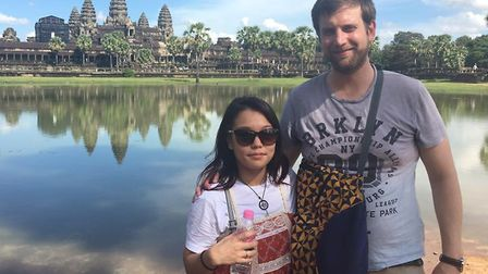 Mike and Jihyeon Harbrow on holiday in Cambodia. Picture: CONTRIBUTED