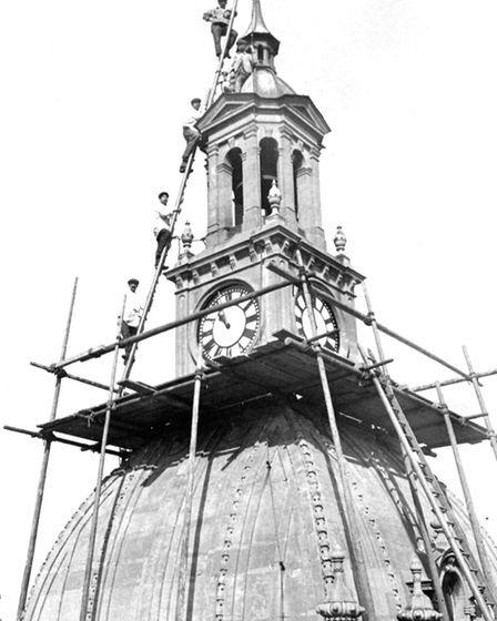 Maintenance work high on the Ipswich Town Hall around 1910. Safety regulations appear to have been v
