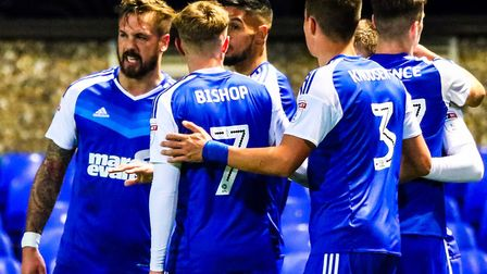 Town players celebrate skipper Luke Chambers (left) putting them into a 1-0 lead against Burton in 2
