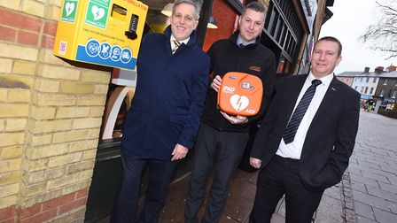 New defibrillator unveiled in Bury St Edmunds. Left to right, Mark Cordell, Paul Hicklin and Paul Di