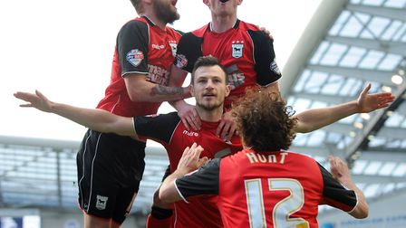 Ipswich's Tommy Smith celebrates giving his team the lead against Brighton at The Amex with Abthony