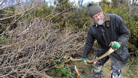 Greenways volunteer Peter Locke carries out heathland management as part of the project's work. Pict