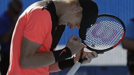 Britains Kyle Edmund reacts after defeating Bulgarias Grigor Dimitrov in their quarter-final at th