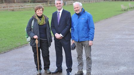 South Suffolk MP James Cartlidge, centre, helps Clare celebrate its Walkers are Welome accreditation