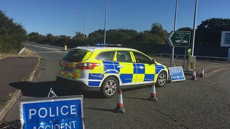 Police closed the A120 after the detached trailer collided with a motorcyclist. Picture: CONTRIBUTED