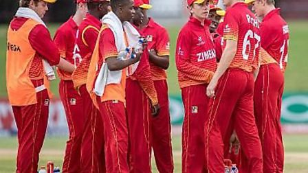 Donald Mlambo (pictured with towel) with his Zimbabwean team-mates during the Under-19s World Cup
