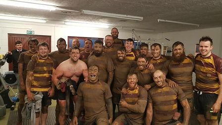 Filthy dirty, but not deflated. Ipswich YM after their loss to Stowmarket in the Suffolk Cup. Photo: