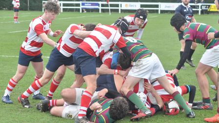 St Joseph's College, in red and white, on their way to victory over Wimbledon College in the RFU Nat