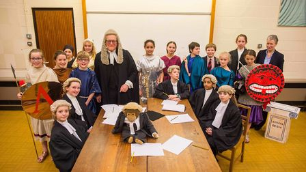 Sir John Waite in character for The Trial of Paris with Woodbridge School pupils and head of classic