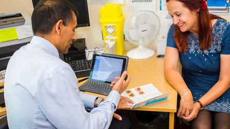Dr Deepak Rallan from the Diamond SkinSafe Clinic takes a patient through the Skin Cancer UK 'How to