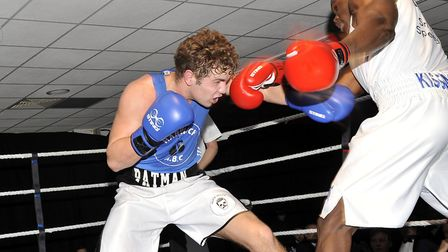 Harwich's Pat Allen Cripps, left, on his way to victory over Attleborough�s Ezra Arenyeka. Photo: CO
