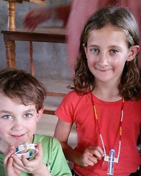 Zachary Burford, six, and his sister Zoe, eight, in Tanzania. Picture CULFORD SCHOOL