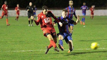 Phil Kelly slots home the 90th-minute winner at Maldon & Tiptree on Tuesday night for AFC Sudbury. P