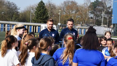 Ipswich Town players Luke Chambers, left, and Cole Skuse talk to young girls during an SSE Wildcats