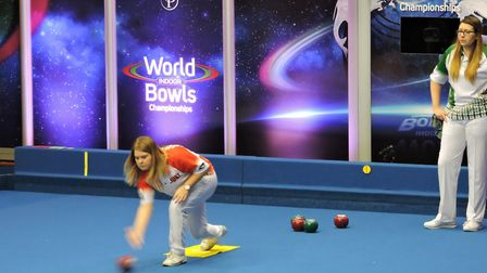 Katherine Rednall delivers a bowl, watched by Bex Field. Picture: David Rhys Jones