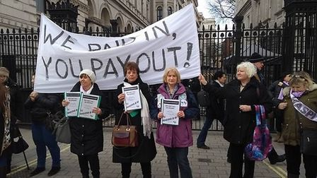 Margaret Thompson and fellow WASPI members during the protest at the gates of Downing Street. 'Why d