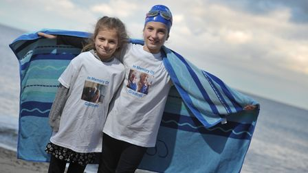 Ellie Kirk, pictured with sister Lucy, will be swimming in memory of her great-grandmother. Picture