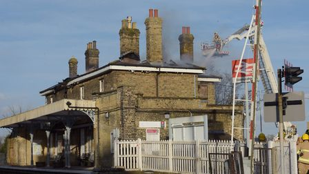 Firefighters tackle a blaze at Saxmundham train station. Picture: SARAH LUCY BROWN