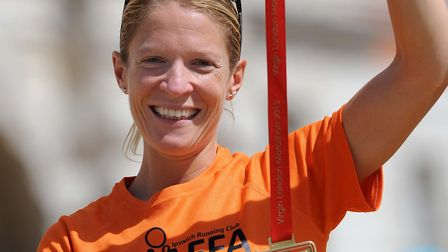 Helen Davies with her finishers' medal after the 2012 London Marathon.
