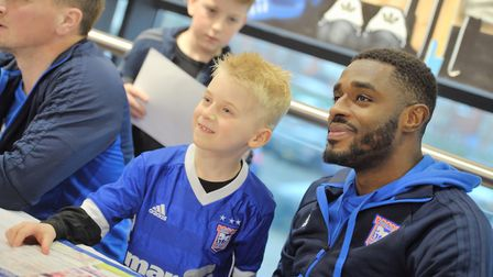 Carayol met young fans, including Elliot Gordon, at Portman Road on Wednesday. Picture: SARAH LUCY