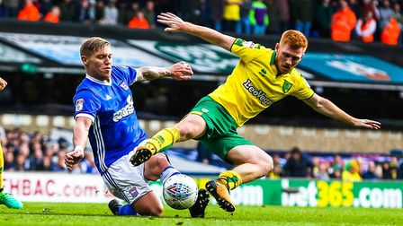 Harrison Reed and Martyn Waghorn in a battle for the ball during Ipswich Town's 1-0 defeat to Norwic