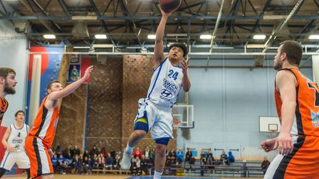 Ipswich's Rabi Rai floats the ball to the basket against Middlesex. Picture: PAVEL KRICKA