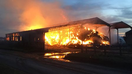 Alderton Road has been closed whilst the fire was being controlled. Picture: MARK ELEY/SUFFOLK FIRE