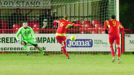 Dan Morphew sends Seasiders' stopper Danny Crump the wrong way to double the score from the penalty