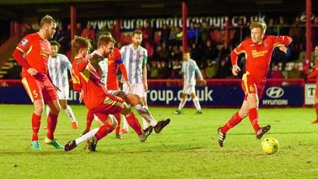 Joe Francis squeezes through the Needham Market defence to open the scoring for the Seasiders. Pictu