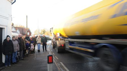 Campaigners, pictured near to the bend inFarnham, beleive traffic problems will worsen without a byp