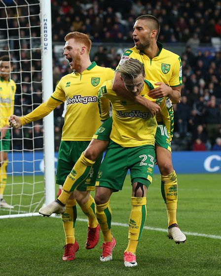 James Maddison is congratulated by Norwich team-mates after equalising at Derby last weekend. Photo: