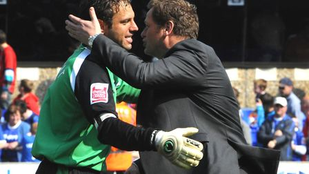 Richard Wright and Jim Magilton embrace after what proved to be the manager's last game in charge.