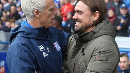 Ipswich Town manager Mick McCarthy shares a joke with Norwich City head coach Daniel Farke before th
