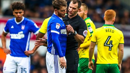 Joe Garner is spoken to by referee Tim Robinson during the first half of Town's 1-0 home loss to Nor