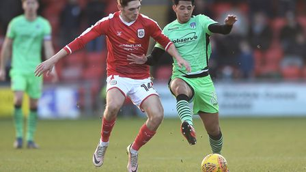 Courtney Senior looks to get past Crewe's Callum Ainley during today's League Two tussle at Gresty R