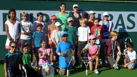 Elena Baltacha with the children at the Indian Wells WTA charitable event. Picture: NINO SEVERINO