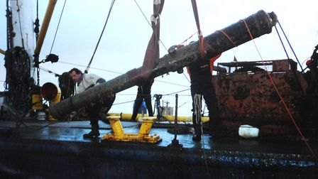 The huge gun is lifted from the seabed on board the diving support vessel Sirius in 1994. Picture: A