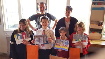 Allyson Yost and Jonathan Nicholson with the winning young artists. Pictutre: GLYN WILLIAMS
