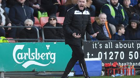 Colchester United boss, John McGreal, urging on his players during the recent defeat at Crewe, admit
