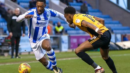 Ryan Jackson out-manoeuvres Shawn McCoulsky during the 2-0 home win over Newport, which was the U's