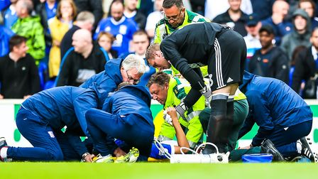 Birmingham keeper David Stockdale supports Andre Dozzell as he is tended to by medics after being in