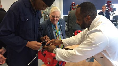 Suffolk New College student Charles Jekenya tried out the new equipment as chairman of governors Rog